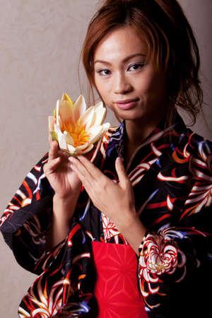 Gorgeous japanese woman wearing kimono robe photo