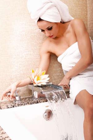 woman in bath: Woman getting ready to take a bath