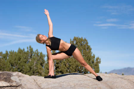 Woman showing a yoga position Stock Photo - 10271171