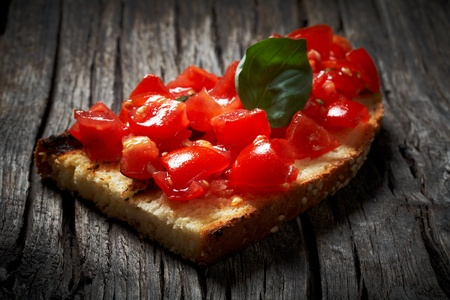 toasted bread covered with chopped tomatoes,basil,garlic and olive oil Stock Photo