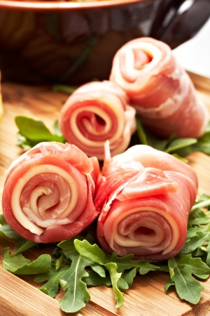 italian raw ham rolled with cheese and mozzarella.