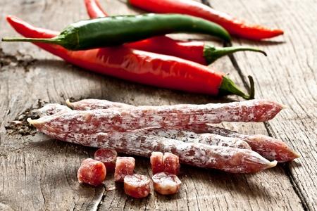 italian salami: some chopped little salami on wood Stock Photo