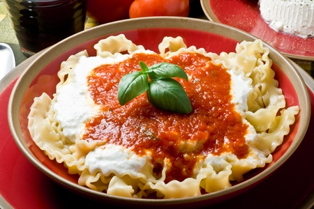 italian pasta with ricotta cheese and tomato photo