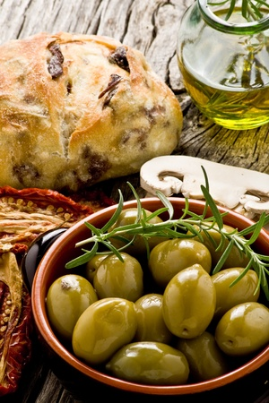 sicilian: rustic appetizer with giants Spanish olives on a bowl