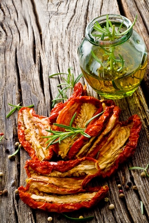sicilian: dried red tomato on wood with olive oil Stock Photo