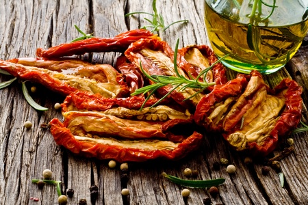 dried red tomato on wood with olive oil Stockfoto