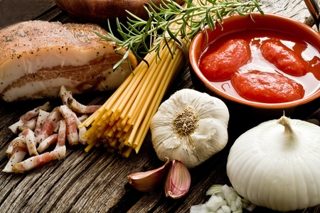 italian traditional pasta amatriciana ingredients on wood photo