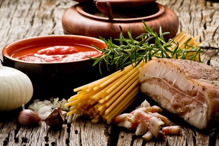 italian traditional pasta amatriciana ingredients on wood Stock Photo - 10995671