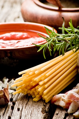 italian traditional pasta amatriciana ingredients on wood