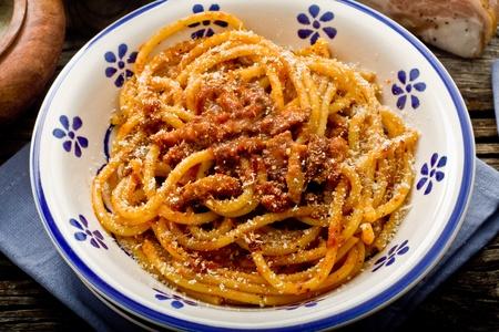 italian traditional pasta amatriciana served ona table wood Фото со стока - 10995676