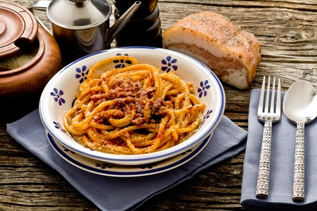 italian traditional pasta amatriciana served ona table wood photo
