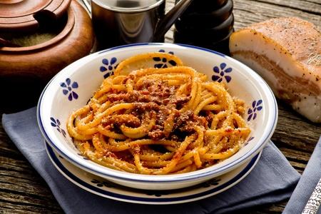 italian traditional pasta amatriciana served ona table wood