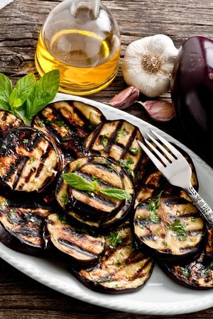 grilled eggplants seasoned with olive oil, garlic and mint photo