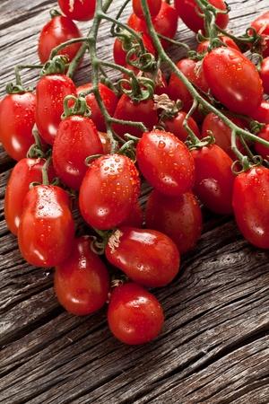 fresh italian cherry tomato on wood photo