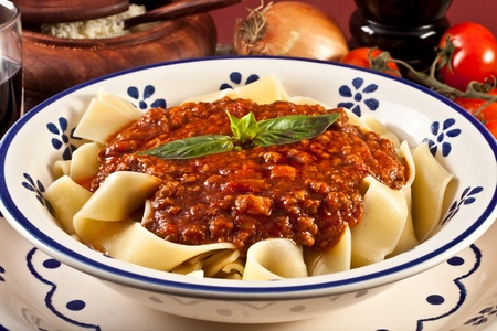 tagliatelle bolognsese - meat sauce and basil photo