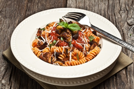 Italian Pasta Norma with tomato,ricotta cheese and eggplants Stock Photo