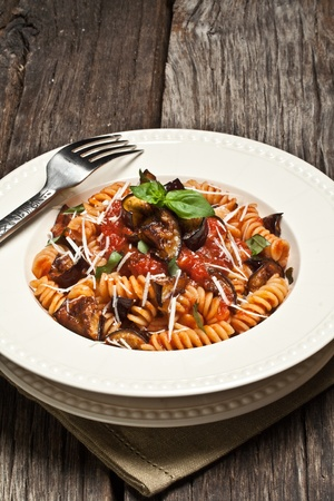 Italian Pasta Norma with tomato,ricotta cheese and eggplants photo