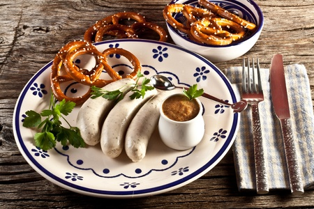 sweet mustard: weisswurst with sweet bavarian mustard and pretzels Stock Photo