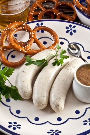 weisswurst with sweet bavarian mustard and pretzels photo