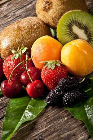 mixed fruit salad with cherry,strawberry, apricot,kiwi and mulberries Stock Photo