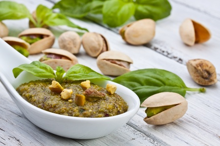 sicilian pistachio pesto sauce with basil and olive oil photo