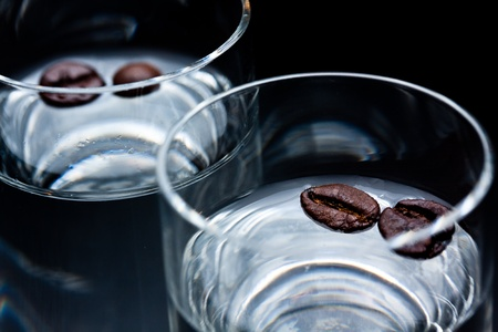 glass of sambuca with coffee beans Stockfoto