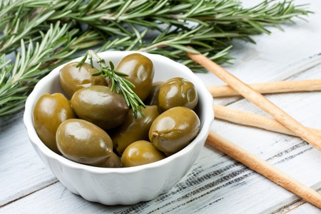green olives in a bowl photo