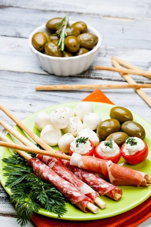 appetizers with salami,ham,tomato and olives photo