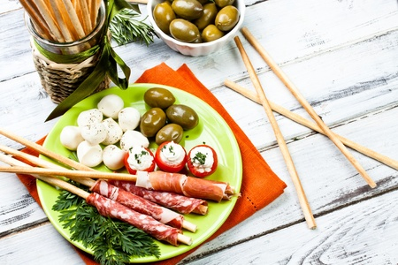 appetizers with salami,ham,tomato and olives Stock Photo - 12890676