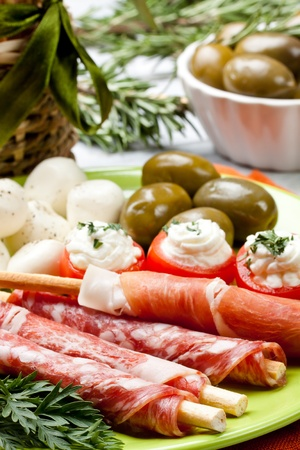 appetizers with salami,ham,tomato and olives