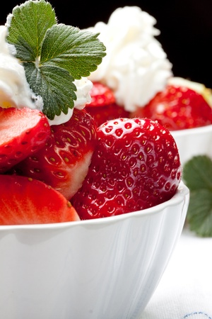 whipped cream: fresh strawberry with whipped cream Stock Photo