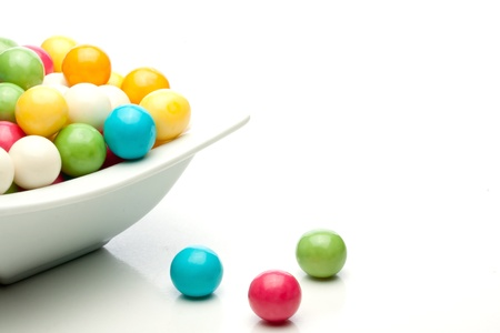 many colored gumballs on a white background Stockfoto