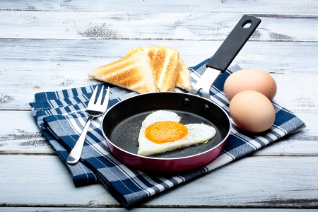 fried egg with toasted bread in a frying pan Stockfoto