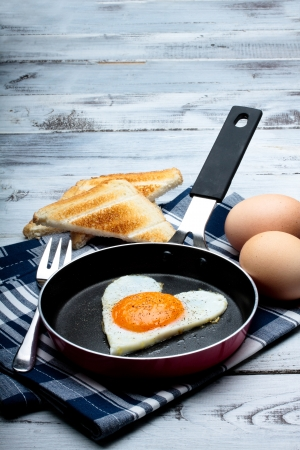 fried egg with toasted bread in a frying pan Stock Photo