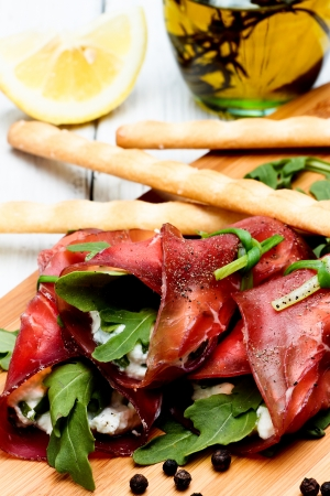 ricotta cheese: bresaola rolls with ricotta cheese and arugola Stock Photo
