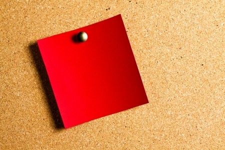 cork sheet: red post-it hanging on a red panel of cork