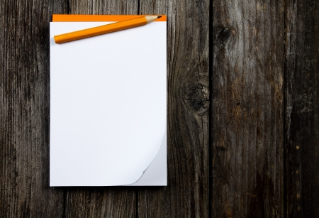 notepad and pencil on a wooden planks Stock Photo