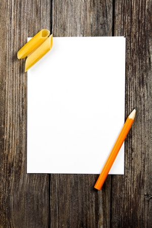 pencil writing: notepad and pencil on a wooden planks Stock Photo