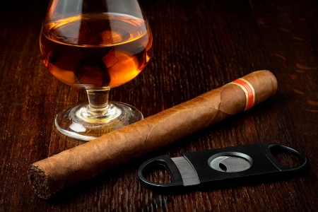 tobacco: cuban cigar with a glass o rum Stock Photo