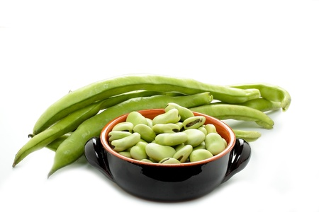 green bean: some raw broad beans on white background Stock Photo