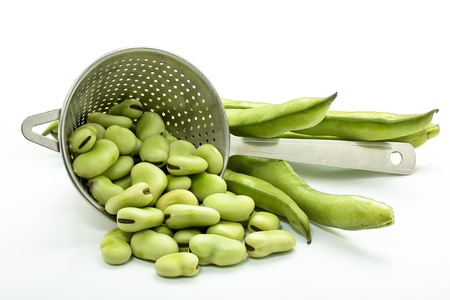 some raw broad beans on white background Stock Photo
