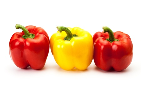 colorful bell peppers isolated on white background