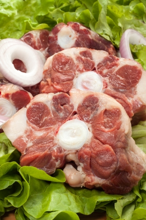 a fresh raw cut of oxtail of cow