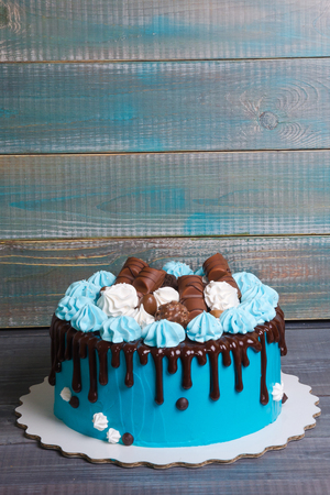 chocolate color drip cream cheese cake with merengues Stock Photo