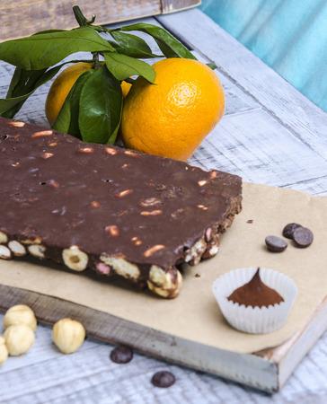 hazel nut: yummy chocolate sweets with hazel nut and tangerines
