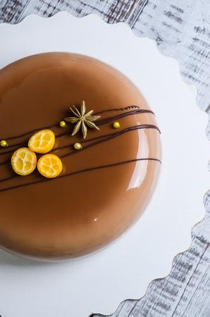 mirror glaze mousse cake with anise and kumquat-