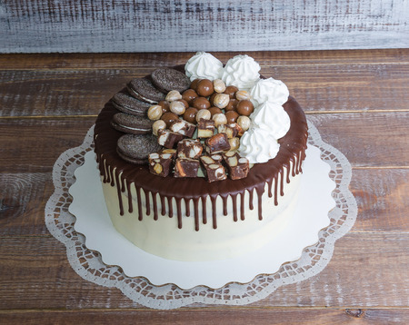 a chocolate color drip cream cheese cake with cookies Stock Photo