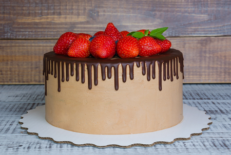 patisserie: Chocolate drip cake with mint and strawberry Stock Photo