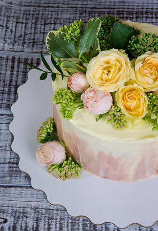 ombre wedding cake decorated with roses and some greenery