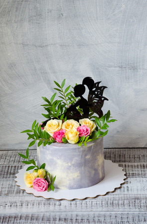 Anniversary cake with roses on a cake stand